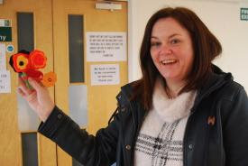 Bridget with the poppies she made at the workshop